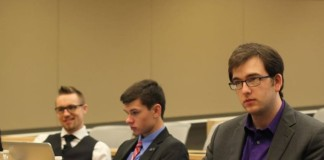 Representatives Mike Hegarty, Colin Delgado, and Josh Barry attend a committee meeting at Buffalo State.
